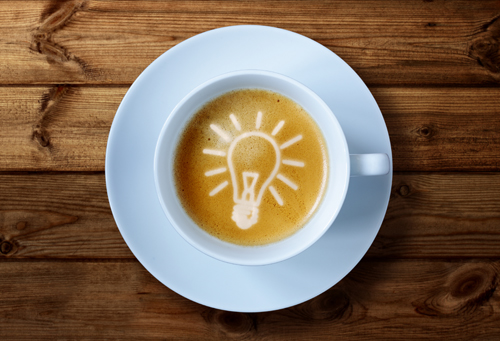 Coffee cup with light bulb idea in the froth concept for ideas,